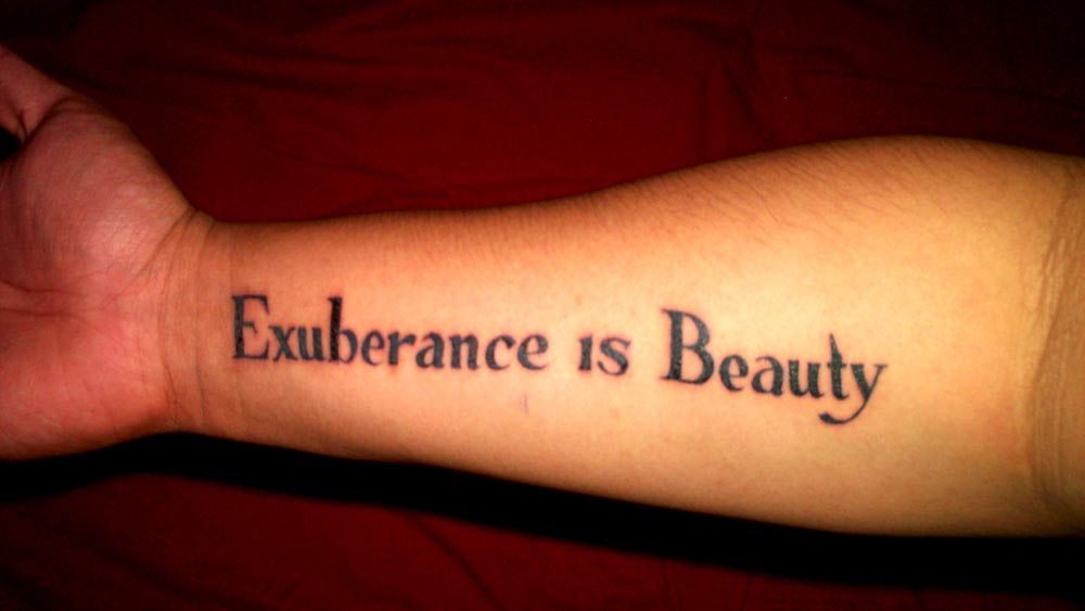 tattoos of quotes about life. I hate tattoos.